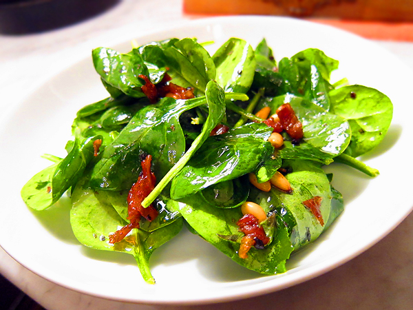 Warm Spinach Basil Salad with Prosciutto and Pine Nuts