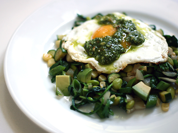 green vegetables with fried egg and pesto