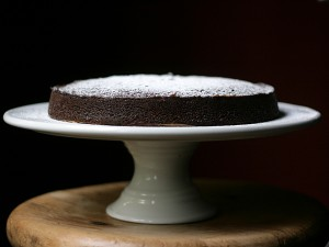 Guinness gingerbread on cake stand powdered sugar