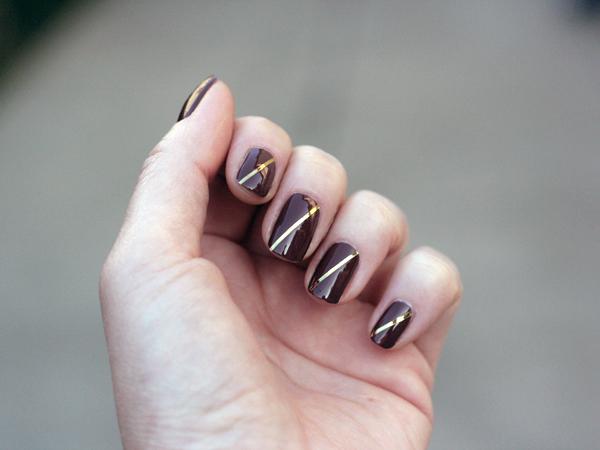 mochaccino mani with gold diagonal stripe