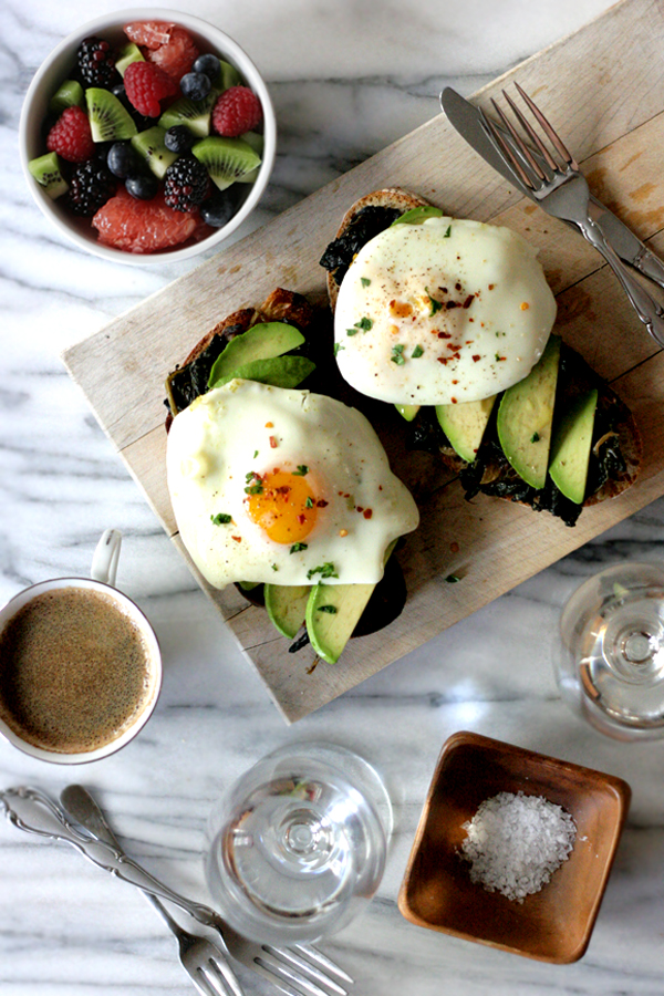 olive oil poached eggs on avocado