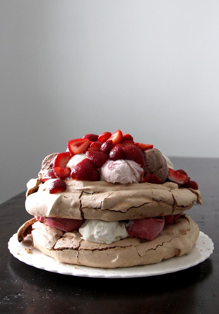 chocolate pavlova layers ice creams and fresh strawberries and raspberries