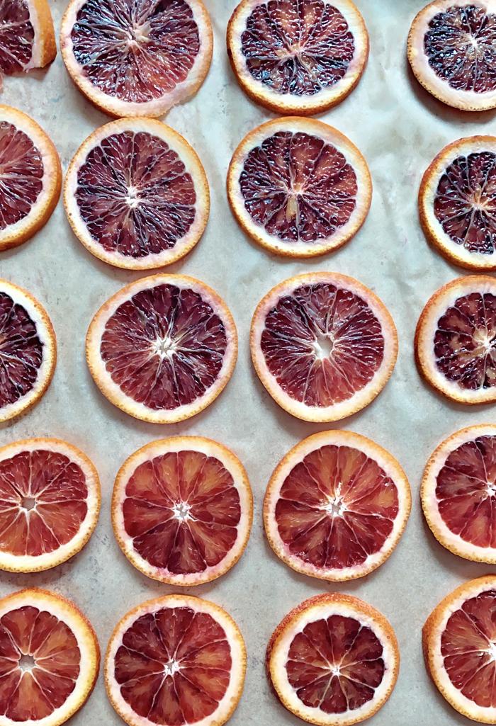 blood orange slices on baking sheet