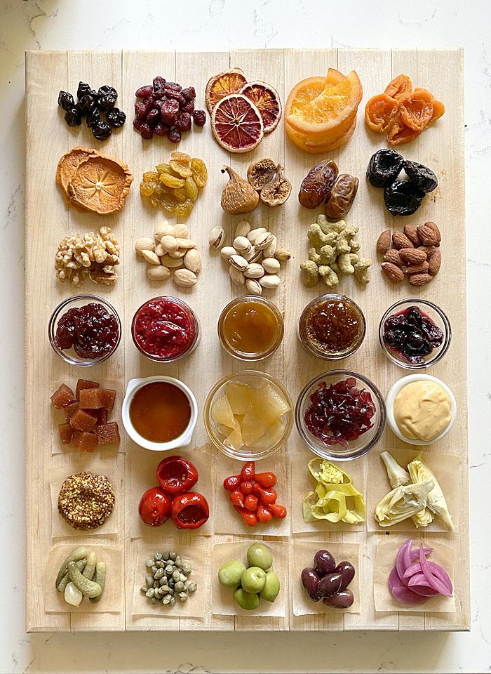 cheese board accompaniments displayed on cutting board