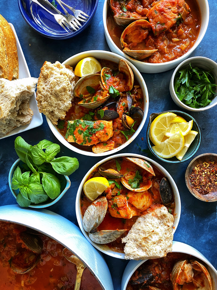 cioppino san francisco seafood stew with sourdough bread in bowls