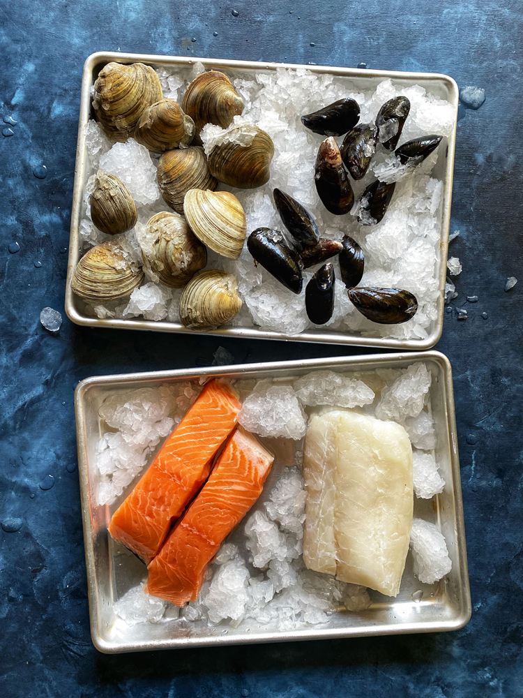 clams mussels salmon white fish on ice