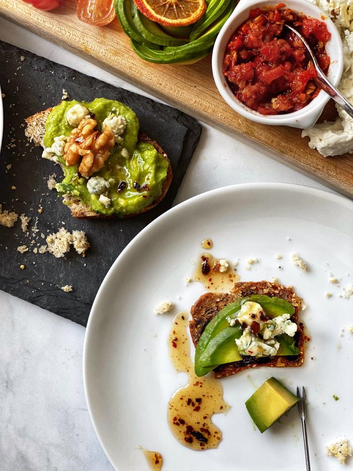 smashed avocado on toast, sliced avocado on cracker
